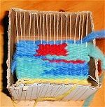 Cardboard Box Weaving - You don't need expensive equipment to weave. A flat piece of cardboard or a cardboard box can easily turn into a loom that you can weave mug rugs, placemats or intricate tapestries on. This is a great project for kids or for teaching beginners to weave.