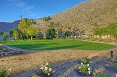 Palm Springs Vacation Rentals. View of Venue #2. Approximately 5,200 Square Feet. Beautifully cut green grass and view of mountains.