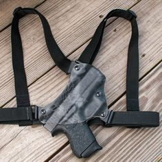 Chest holster,The creation of this chest holster was guided by a Woman of small stature. After buying a Litepath Chest Rig and finding it too large for her small frame, she offered up herself as a 1 woman R&D facilitator.