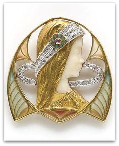 Masriera y Carreras - An art nouveau plique-á-jour enamel, ivory and diamond pendant/brooch - circa 1915.