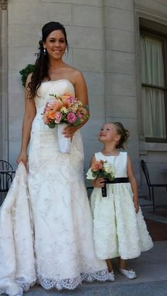 Adorable picture of flower girl and bride