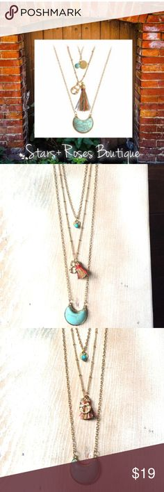 Boho Chic Layered Necklace Layered necklace with charm, tassel, and turquoise stone.  Costume jewelry, lobster claw closure, gold tone. This layered necklace would be perfect for festival season, to wear to the office or casual jewellery for any occasion.  #SR-020917 Stars + Roses Jewelry Necklaces