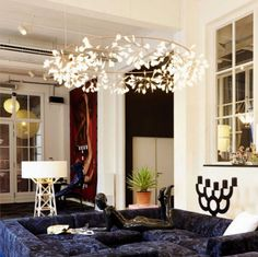 Standout with this stunning handcrafted Acrylic Firefly Tree Chandelier! This chic piece is perfect for weddings and brunches. The LED Bulbs are energy efficient and emit a white / warm light with less heat. These firefly crown lights will definitely impress your guests!  #GoldChandelier #ContemporaryChandelier #LargeChandelier  #Livingroomideas #Livingroomdecor