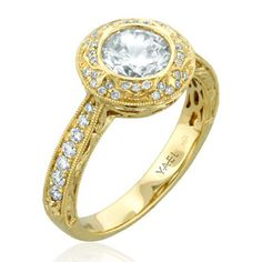 It is easy to fall in love with the Novelique Collection by Yael Designs. This 18k yellow gold engagement ring features a 1 carat diamond, accented with 0.27 carats of brilliant cut diamonds. Item # 09498. #baronsjewelers #yaeldesigns #engagement #novelique #diamondring @yaeldesigns