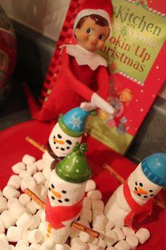 Elfie making snowmen