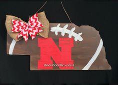 State of Nebraska cutout football N Husker door hanger decoration http://www.doordoodles.com/store/p302/Nebraska_state_football_with_%22N%22.html