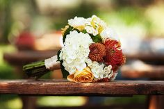 warm and colorful fall wedding bouquet - photo by Poser Image | via junebugweddings.com