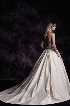 View Silk Dupioni Wedding Dress - Style #4606 from Paloma Blanca. Strapless ruched bodice. Sweetheart neckline. Full skirt. Side pockets. Cathedral Train.