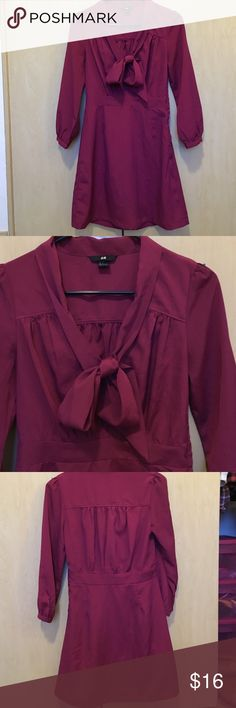 H&M dress Maroon long sleeve dress that would be perfect for the holidays. Button detail on sleeves, pretty bow tie on the front, hits a bit above the knee. 100% polyester. No flaws. H&M Dresses Long Sleeve