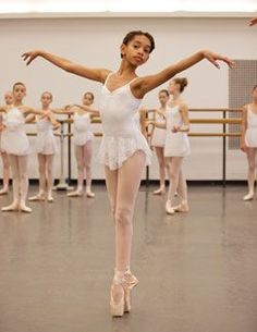This young lady is such a graceful looking kid practicing her ballet stance. How adorable.