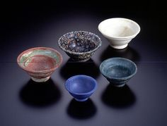 https://flic.kr/p/84Pd2v | An Assemblage of Roman Cast Glass Patella Cups | Cast glass and cast mosaic glass, 1st century B.C.E./C.E.  A, Cup cast from opaque red glass. While the same shape as cat. No. 78, here there is no groove between the vessel body and foot. Both inner and outer surfaces show green-colored iridescence. This vessel shape is commonly known as a patella cup, and is one of the most widely known glass vessel types from the early Imperial Roman period, when it also appeared…