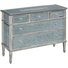 Antiqued mirrored drawers add shine and glamour to this chest of drawers. Five drawers are accented with mirrored hardware while carved legs and fluting add int...