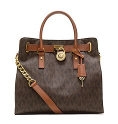 The Hamilton signature tote from MICHAEL Michael Kors blends fashion and function. We love the chain detail and logo-engraved lock. leather magnetic-snap closure goldtone hardware four slip pockets, one zipper pocket inside double handles x x Michael Kors Hamilton, Michael S, Michael Kors Tote, Handbags Michael Kors, Tote Handbags, Tote Bags, Brown Handbags, Fashion Handbags, Cheap Handbags