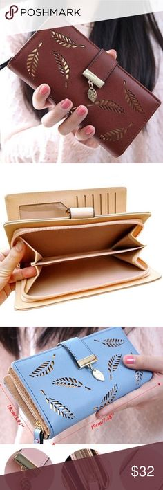 Golden Leaf Faux Leather Clutch Wallet •NEW! Leaf patterned faux leather clutch wallet  •Color- Coffee {brown w/ tan interior} •Faux leather  •Multi use with plenty of storage  •Zipper enclosure / durable hold  •Accented with a golden leaf buckle  •A MUST HAVE! Bags Wallets