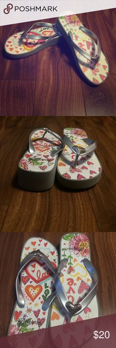 Brighton wedge flip-flops Brighton wedge flip-flops with colorful heart/love designs. NWOT, NEVER WORN. Brighton Shoes Sandals