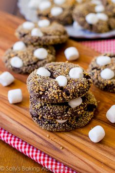 S'more Chocolate Crinkle Cookies - soft, fudgy, brownie cookies rolled in graham cracker crumbs and topped with melty marshmallows. The best s'more treat!  sallysbakingaddiction.com