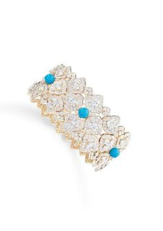 Piaget's High Jewelry Collection: Gold Bracelet 18k pink gold set with 105 marquise-cut diamonds, five turquoise beads and 717 brilliant-cut diamonds.