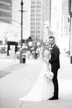 A classic bride and groom portrait in New York City | @biasampaiophoto | Brides.com