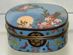 """A fine Antique Japanese wireless cloisonné box has a blue ground decorated with flowers and a stylized butterfly motif. Measuring 2 ½"""" x 1 ¼"""" x 1 1/16"""" high, it is lined with blue felt ~ circa 1900."""
