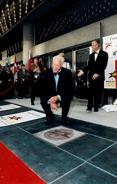 """2000 Canada's Walk of Fame Inductee, """"Mr. Hockey"""", Gordie Howe posing with is newly unveiled star. #CWOF Read more: http://www.canadaswalkoffame.com/inductees/2000/gordie-howe"""