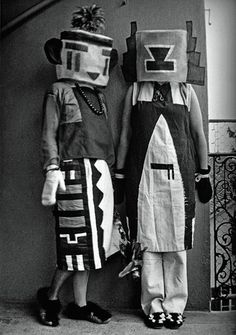 Sophie Tauber-Arp and her sister, dressed in costumes that Tauber-Arp designed for an interpretive dance to a poem by Hugo Ball. (1916)    Dada Siegt!