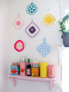 Pot-holders on the wall-doing this once we move with the ones my grandmother made