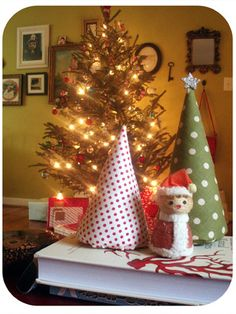 Cover varying size cardboard cones with fun scrapbook paper glitter or other items to make trees