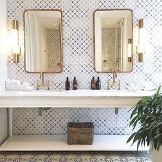 patterned tile on vanity wall in bathroom with open washstand and brass hardware, finishes and lighting