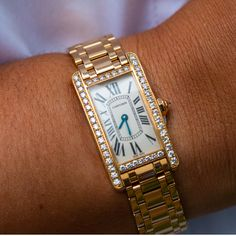 With the holidays just around the corner, you can't go wrong by surprising the lady in your life with a classic wristwatch. The #Cartier Tank Americaine will surely 'WOW' her with an elegant 18K yellow gold case and diamond bezel. Cartier Tank Americaine, Swiss Watch Brands, Tank Watch, Gold Diamond Watches, Cartier Bracelet, Pear Shaped Diamond, Fine Watches, Cartier Watches