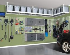 Way cool garage storage! Paint the cement, and lots of genius ways to store things on the wall!