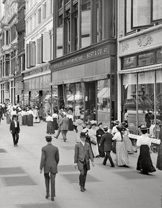 """Anna Leatherbury to Old Images of New York Group    A great street scene view of New York City during America's Gilded Age era, c.1905. Pedestrians and shoppers walking aside storefronts, including; Best and Company - Lilliputian Bazaar, which was originally a childen's clothing store, founded in c.1879. Formerly located in the """"Ladies Mile"""" near, 6th Ave, & West 23rd, St., NYC. ~ {cwlyons} ~ (Image: librar-y tumblr)"""