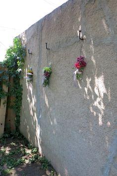 Backyard bridal shower - mason jars hanging with flowers