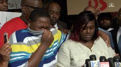 The son of Anton Sterling, in tears, stands next to his mother as she speaks about their life after Sterling's deadly altercation with police in Baton Rouge, Louisiana.