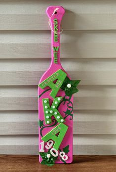 """Customized paddle keepsake for the ladies of Alpha Kappa Alpha Sorority, Inc. Paddle measurements are 23.88""""L x 5.5""""W x 3/4""""H. ***As of March 1, we no longer have mini, wall, and skinny paddles because our supplier has closed their stores. Aka Sorority Gifts, Alpha Kappa Alpha Sorority, Zeta Phi Beta, Sorority Crafts, Sorority And Fraternity, Alpha Kappa Alpha Paraphernalia, Greek Crafts, Greek Paddles, Fashion Eye Glasses"""