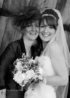 Mother of the Bride wears Sarah Crozier headpiece with John Charles outfit