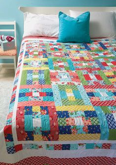 Strip-pieced floral fabrics bring this cute spring-like bed-size quilt pattern to life. Spring quilts are so refreshing! Especially when they're adorable.