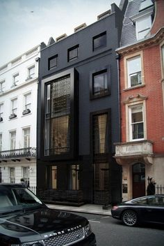 All black everything- the black  white and brick building all complement the other. Beautiful.