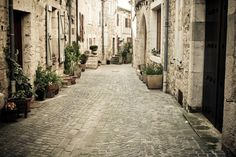 This charming image shows the cobbled streets of the quaint village,Castelnau-de-Montmiral situated in the southern Pyrenees region of France. Our Cobbled Streets wall mural adds a fantastic perspective to a room, with the view focused down into the distance of the charming narrow village alleys.