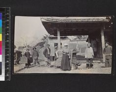 """1910-1914""""Yungchun: a Visitor"""". The visitor is possibly Miss Seidlmann of the Methodist Episcopal Mission. She is shown outside Yongchun temple just having dismounted from a palanquin. Carriers and servant with hamper are shown."""