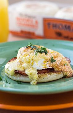 Classic Cozy Eggs Benedict — This brunch time favorite of poached egg, Canadian bacon and hollandaise sauce over a toasted Thomas' English Muffin is in a class by itself.