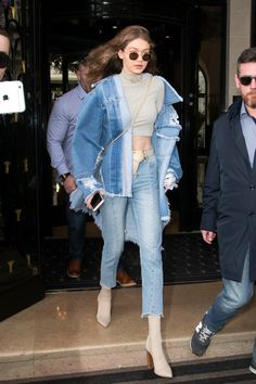 Before walking the Fall 2017 Balmain runway in Paris, Gigi Hadid made a statement in the streets. The supermodel left her hotel in a few signature pieces,