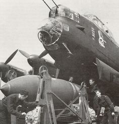 "A Royal Air Force Avro Lancaster being ""bombed up"" with a 12,000 pound Tallboy earth-penetrating bomb."