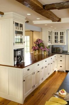 Beadboard kitchen, wood countertops. want to pain out beadboard cabinets white