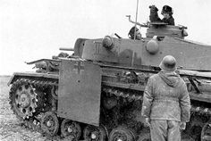 A German officer tanks to a Panzer III commander...