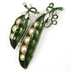"Trifari brooch, early 1950s, at N&N Vintage Costume Jewelry -- the source of many rare items and exquisite ""book pieces."""