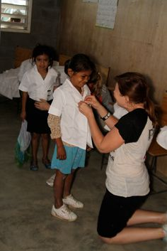 Distributing school uniforms in Honduras, through Clothes4Souls!