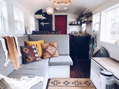 This old school bus was converted into a luxury tiny home on wheels. The kitchen has stunning fixtures and appliances, the bedroom has a boho and farmhouse modern feel and the living room area is extra cozy. Open Space Living, Living Spaces, Living Room, Tiny Living, Old School Bus, Tiny House Luxury, Villa, White Shiplap, Queen Bedding Sets