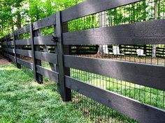 At first glance, this fence is pretty basic. A nice, solid stained black with wide boards that don't totally obstruct the view beyond it. But if you look closely, you can see the addition of thin chicken wire. This is a great idea if you want a modern, stylish fence but still have to either keep your small pets in or small critters out. Genius and super easy.