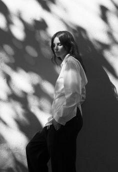 Dappled summer light and a white shirt