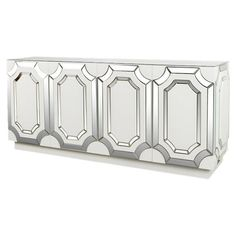 Showcasing 4 doors and mirrored paneling, this eye-catching sideboard is perfect for stowing spare dinnerware and linens in your dining room or displaying a ...